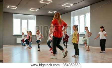 Group Of Little Boys And Girls Dancing While Having Choreography Class In The Dance Studio. Dance Te