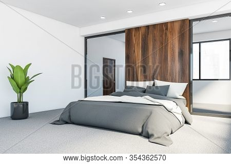 Corner Of Modern Master Bedroom With White And Wooden Walls, Carpeted Floor, Comfortable King Size B