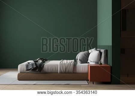 Interior Of Luxury Master Bedroom With Green Walls, Wooden Floor, Comfortable King Size Bed With Ora