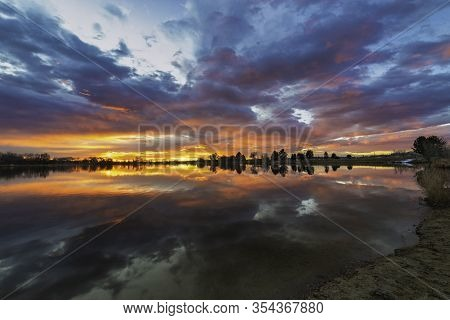 Colorful Sunrise Reflecting In A Colorado Lake Along The Front Range