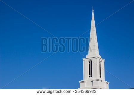 White Steeple And Tower Atop Neighborhood Church