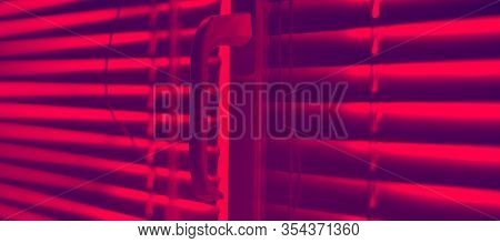 Closed Horizontal Blinds With Rope And Handle. Red Tone.
