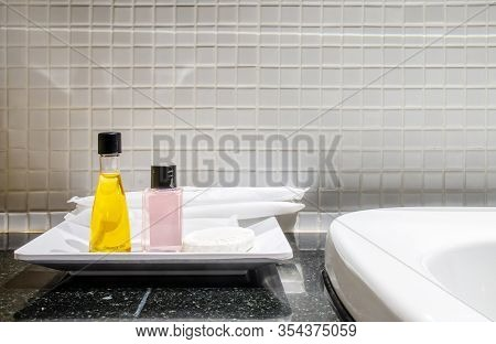 Hotel Bathroom, Complimentary Toiletries ,shampoo And Shower Gel, Set Of Toiletries Placed At Sink I