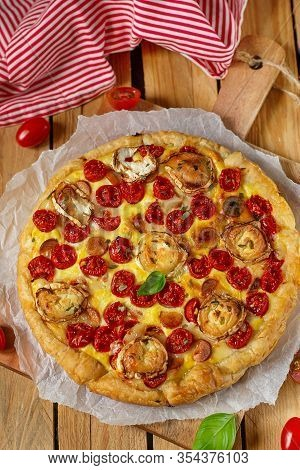 Savoury Pastry Tart Quiche With Cottage Cheese, Cherry Tomatoes And Goat Cheese
