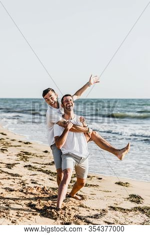 Best Friends Cuddling On The Beach,vacation With A Friend At Sea,fooling Around With A Friend,friend