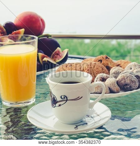 Healthy Breakfast On The Table With A Cup Of Espresso Coffee, A Glass Of Orange Juice, A Plate Of Fr