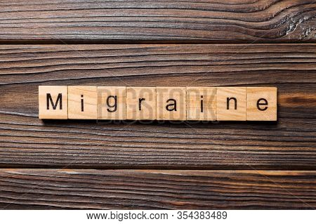 Migraine Word Written On Wood Block. Migraine Text On Wooden Table For Your Desing, Concept