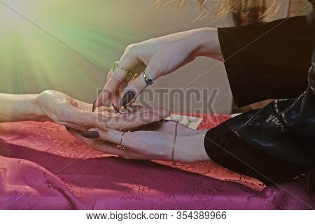 Girl Palmist Reads The Lines Of The Fate Of A Woman. Prediction Of The Future, Clairvoyance. Paronor