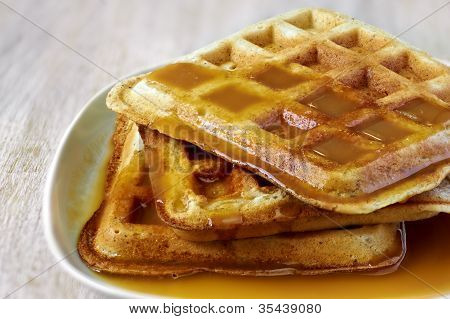 Stack Of Homemade Waffles On The Plate With Sweet Sauce On Top