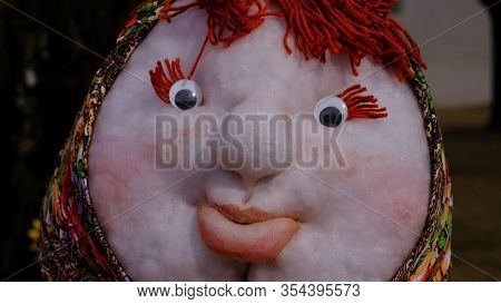 Doll On Shrovetide. Toy From Russia For The Winter Farewell