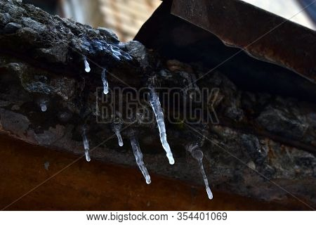 Ice Icicles Hanging From The Eaves Of The Entrance