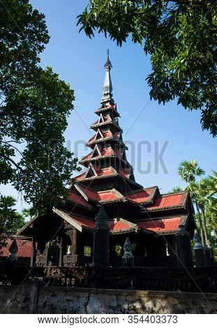 Seven-tiered spire of Bagaya Monastery - teak wood buddhist monastery in Inwa (Ava), Myanmar