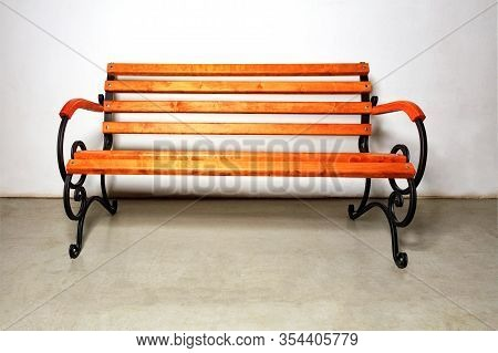 A Beautiful Wooden Bench For Rest With A Metal Forged Base For Landscaping Walking Areas In City Par