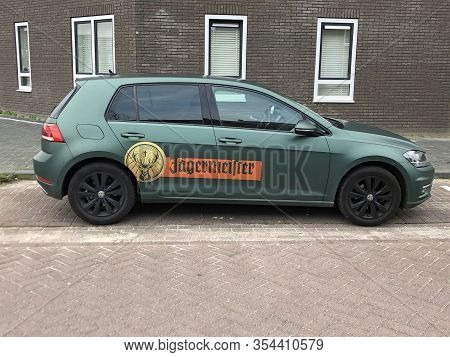 Almere, The Netherlands - March 6, 2020: Green Jagermeister Promotion Car Parked By The Side Of The