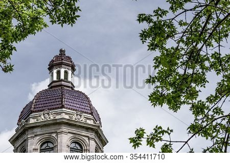 Old Dome Seen Though Green Leaves. Maisonneuve Market In Montreal, Quebec.