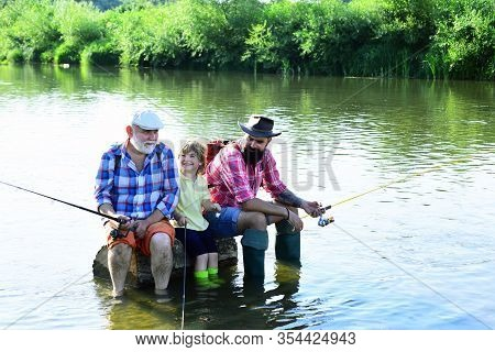 Outdoors Active Lifestyle. Grandfather And Grandchild. Happy Weekend Concept. Fishing Became A Popul