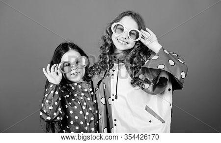 Waterproof Accessories For Children. Sisters Happy Wear Waterproof Cloak. Enjoy Rainy Weather With P