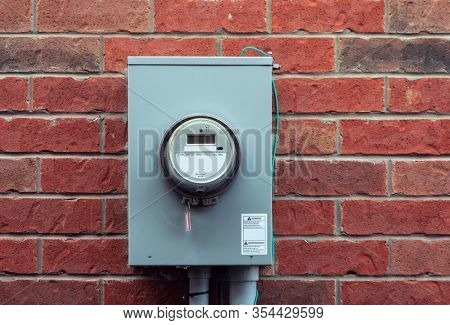 Electricity hydro power electric energy smart meter on the brick wall