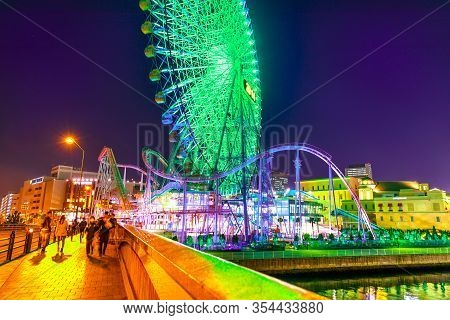 Yokohama, Japan - April 21, 2017: Asian People Cross The Bridge Joining Cosmo World Amusement Park I