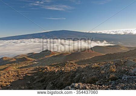 Evening Clouds On A Volcanic Landscape On Mauna Kea In Hawaii