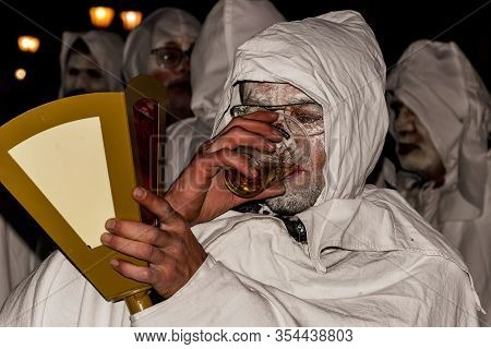 Puget-theniers, France - February 26, 2020: A Participant Of The Traditional Annual Parade Of White