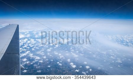 Aerial View At Sky And Earth Over Clouds