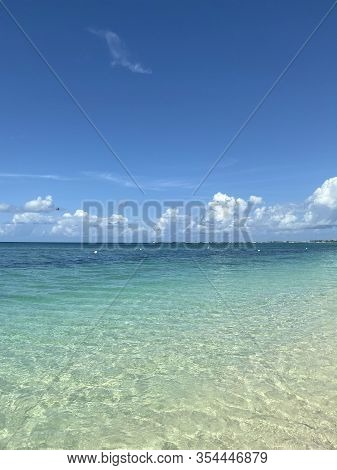 Landscape. A View Of The Blue Ocean From The Beach Line. Beautiful Natural Background. Horizon Line
