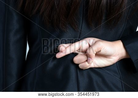 Close Up Businesswoman With Her Fingers Crossed Behind Her Back - Concept For Good Luck Or Dishonest