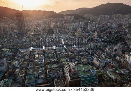 Busan, South Korea - March 14, 2018: Busan Citycape With Back Lit Sun, Bird Eye View. Jung-gu Distri