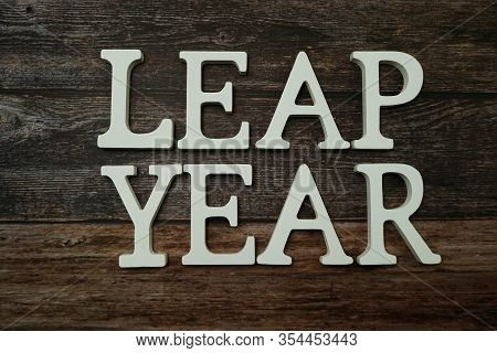 Leap Year Alphabet Letter With Space Copy On Wooden Background
