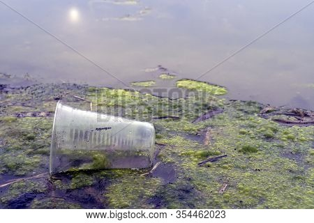 A Plastic Cups Floating In Polluting River Or Lake, Environmental Problem With Plastics Pollution La