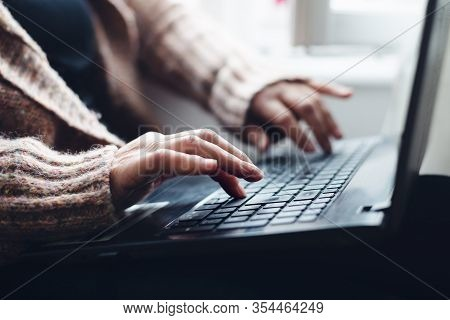 Woman Working On Laptop From Home. Busy People Lifestyle. Woman Typing On Laptop Computer. Work From