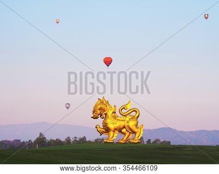 Chiang Rai, Thailand - February 12 2020 : Large Golden Singha (lion) Statue Over Sunrise Sky Backgro