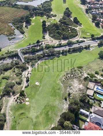 An Aerial View Of A Golf Course In The Southern Sydney Suburb Of Maroubra. The Pressures Of Urban De