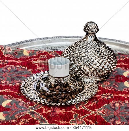 Traditional Turkish Copper Coffee Cup In A Turkish Delight Plate With Roasted Coffee Beans On A Tray