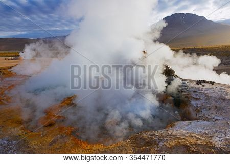 Steam Of One Of The Beautiful El Tatio Geysers At Sunrise, Chile. Located At 4,320 Meters Above The