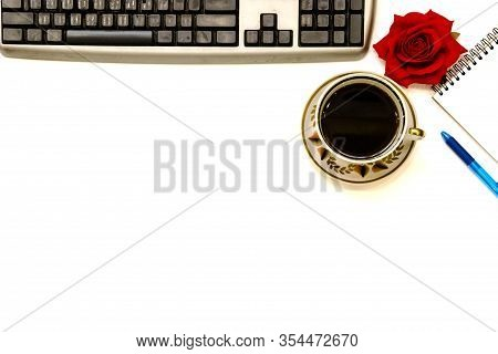 Pictured In The Photo Cup Of Coffe And Open Notebook On White Background