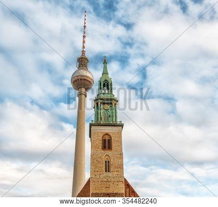 Berlin, Germany - December 9, 2019: Belltower Of St. Mary's Church Or Marienkirche. Tv Tower Near Th
