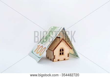Financial Growth Concept, Real Estate Tax, Buying And Selling Houses, Insurance. A Miniature House A