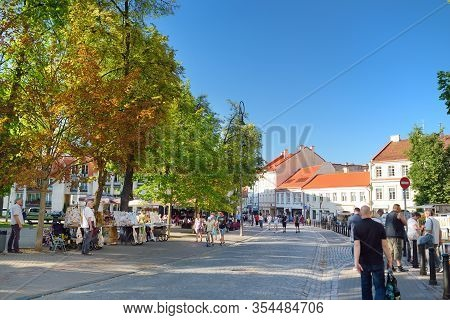 Vilnius, Lithuania - June 18, 2019: Townspeople And Tourists Strolling On The Pilies Street, The Old