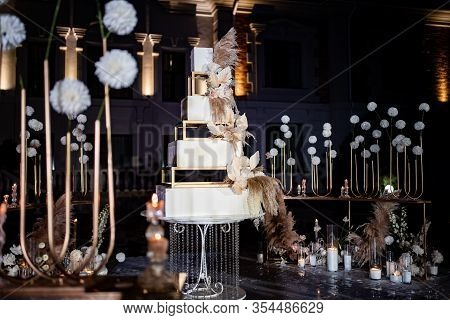 Wedding Decor. Unusual White Tiered Wedding Cake. A Traditional Treat For The Feast Of The Bride And