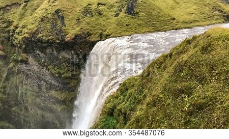 Skogafoss Waterfall In Iceland During Heavy Rainfall Seen From Above