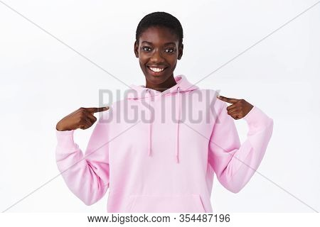 Cool Young African-american Girl With Short Hair Pointing At Herself And Smiling, Boastful Talking O
