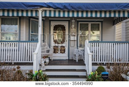 Ocean Grove, Nj / Usa - March 5, 2020:  Victorian Homes Painted In Complimentary Colors And Ornate D
