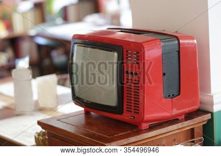 Old Black And White Tv From Last Century On Table On Cafe Background Close Up Photo