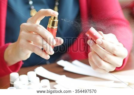 Perfumer Hand Try Aroma Oils Spray With Blotters Close Up Photo