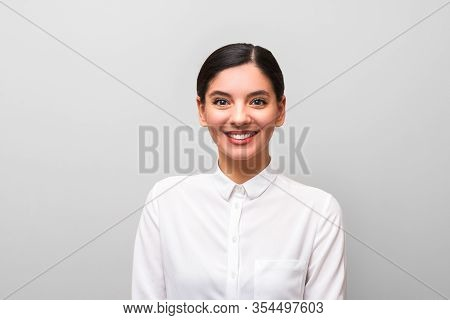 White Collar Worker Young Attractive Brunette In White Shirt With Red Lips, Business Makeup And Hair
