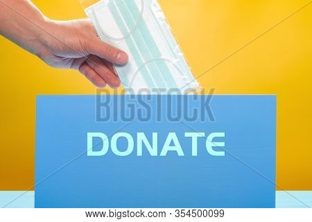 Man Donating Medical Mask The Word Donate Contains Clipping Path And Can Be Removed