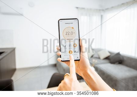 Controlling Home Heating Temperature With A Smart Home, Close-up On Phone. Concept Of A Smart Home A