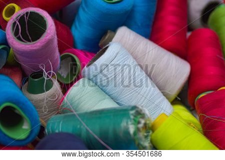 Pile Of Random Colorful Sewing Threads Background